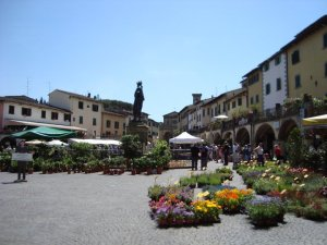 Shop at an open air market during your Italian villa rental experience.